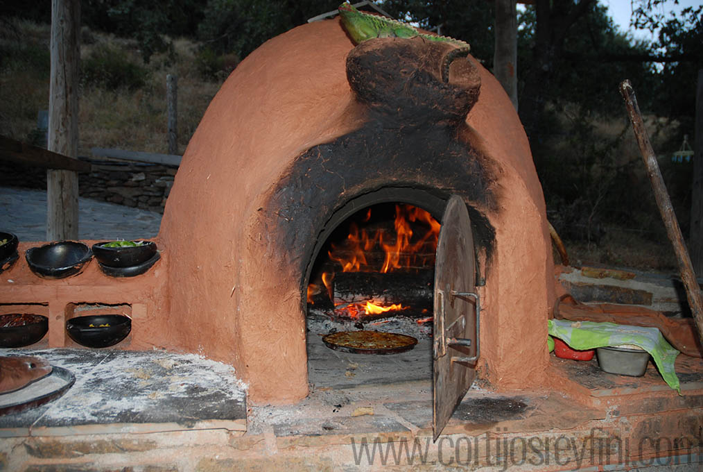 Pizza cooking in the clay oven